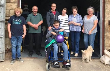 Volunteers and family at the entrance to The Bunker, the base for the Balmedie Beach Wheelchairs