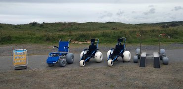 Sandcruiser wheelchair, hippocampe wheelchairs, nomad desert platform lined up on Balmedie beach